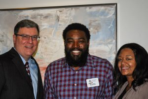 Alumni Christine Rattler and Husband with Bill Guess